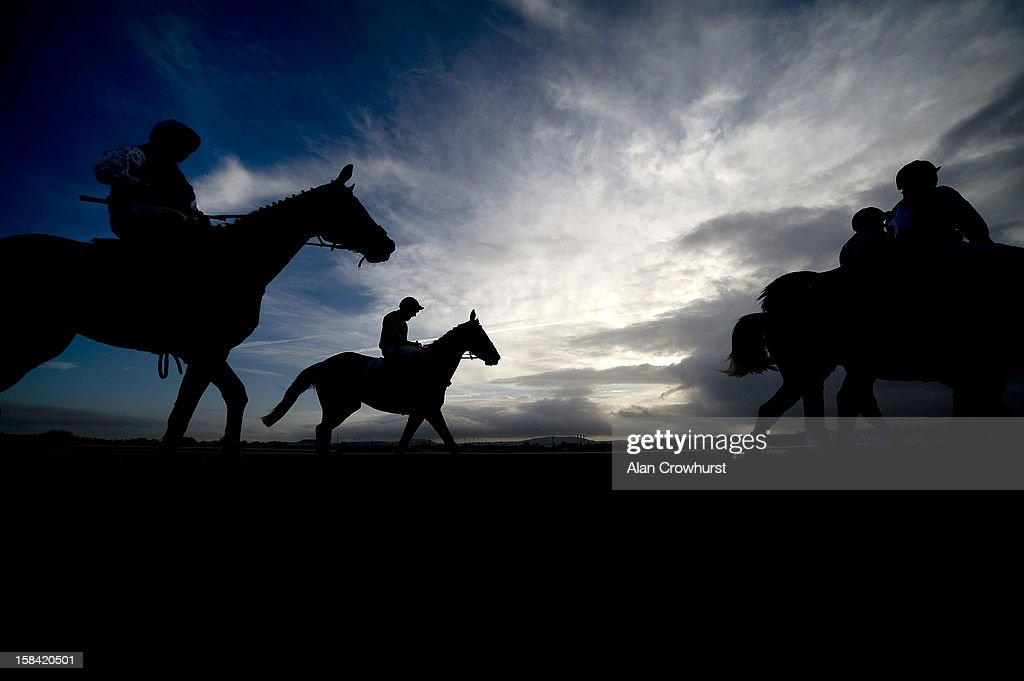 Runners return after finishing during the last meeting to be held at Hereford racecourse after 241 years of racing on December 16, 2012 in Hereford, England.