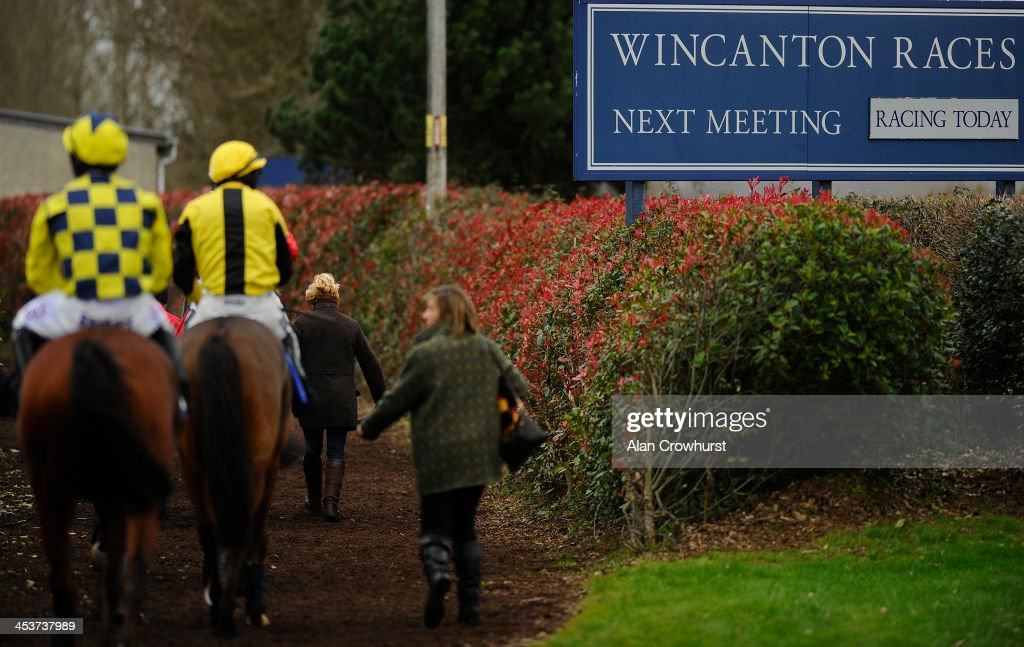 Runners return to the unsaddling enclosure at Wincanton racecourse on December 05, 2013 in Wincanton, England.
