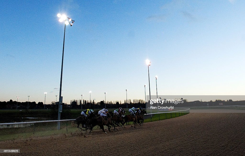 Runners round the bend in The Compare Bookmakers At bookmakerscouk Handicap Stakes at Wolverhampton racecourse on January 09 2014 in Wolverhampton...