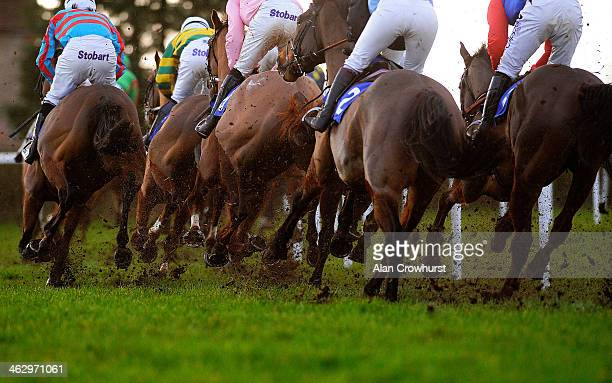 Runners round the bend on the heavy going at Wincanton racecourse on January 16 2014 in Wincanton England