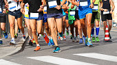many fast runners run at finish line during race in the city