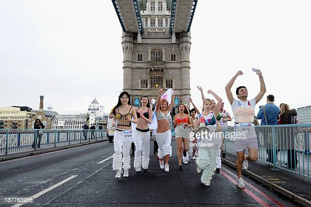 Runners run over Tower Bridge during the Team Pants And Bra photcalll on January 26 2012 in London England Team Pants and Bra sprinted through...