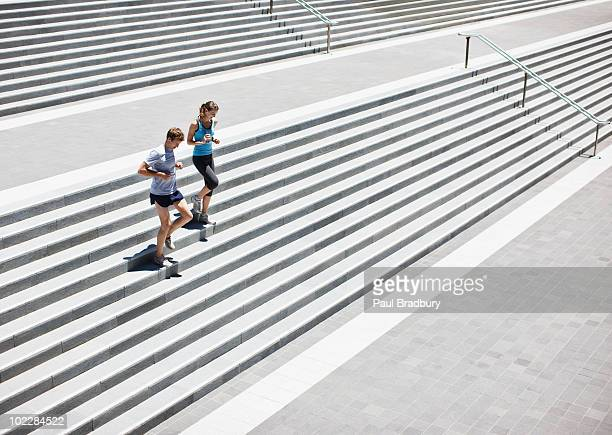 Runners running down stairs