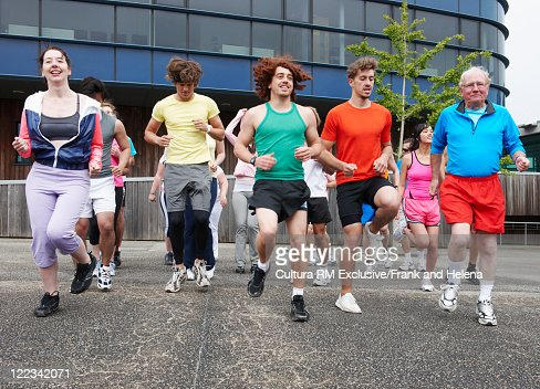 Runners running in place on city street : Stock Photo
