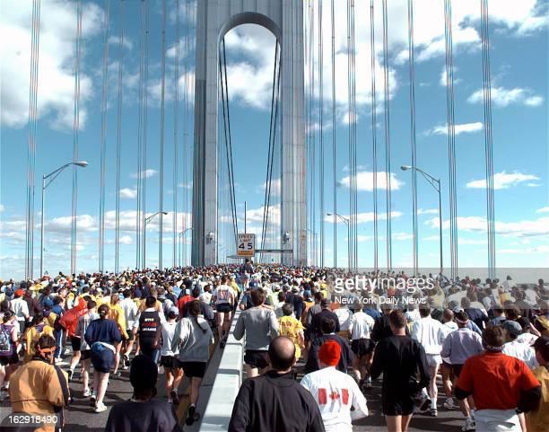 Runners running over the VerrazanoNarrows Bridge during the 1999 New York City Marathon