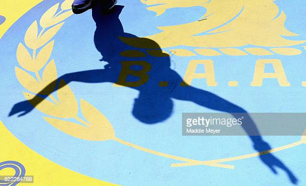 A runner's shadow is seen crossing the finish line during the 120th Boston Marathon on April 18 2016 in Boston Massachusetts