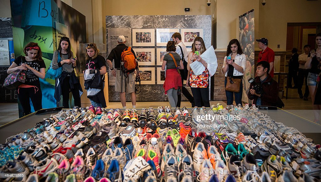 Runner's shoes are laid out in a display titled, 'Dear Boston: Messages from the Marathon Memorial' in the Boston Public Library to commemorate the 2013 Boston Maraton bombings, on April 14, 2014 in Boston, Massachusetts. Last year, two pressure cooker bombs killed three and injured an estimated 264 others during the Boston marathon, on April 15, 2013.
