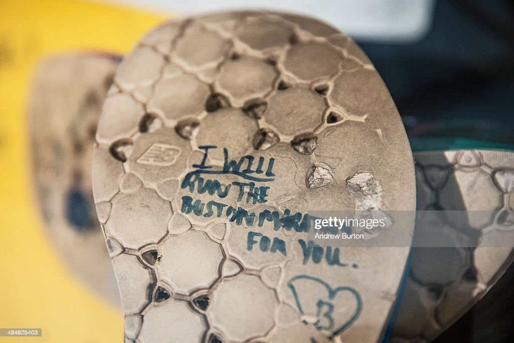 A runner's shoes read, 'I will run the Boston Marathong for you,' in a display titled, 'Dear Boston: Messages from the Marathon Memorial' in the Boston Public Library to commemorate the 2013 Boston Maraton bombings, on April 14, 2014 in Boston, Massachusetts. Last year, two pressure cooker bombs killed three and injured an estimated 264 others during the Boston marathon, on April 15, 2013.