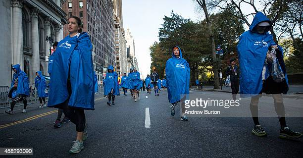 Runners slowly walk to meet loved ones after finishing the TCS New York City Marathon on November 2 2014 in New York City