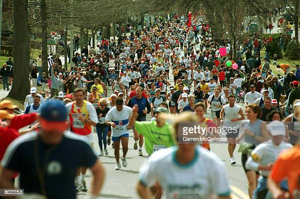 Runners start up Heartbreak Hill April 16th 2001 during the 105th Boston Marathon in Boston MA The Boston Marathon is the oldest marathon in the US