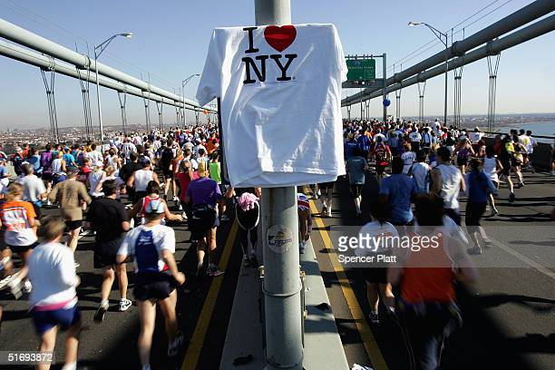 Runners stream over the Verrazano Narrows Bridge at the start of the New York City Marathon November 7 2004 in the Brooklyn borough of New York City...