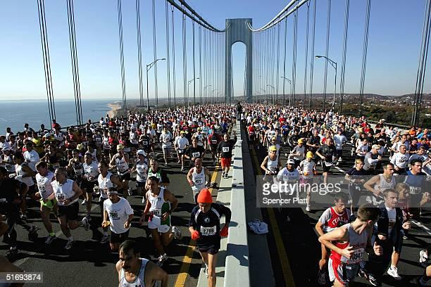 Runners stream over the Verrazano Narrows Bridge at the start of the New York City Marathon November 7 2004 in the Brooklyn borough of New York City...
