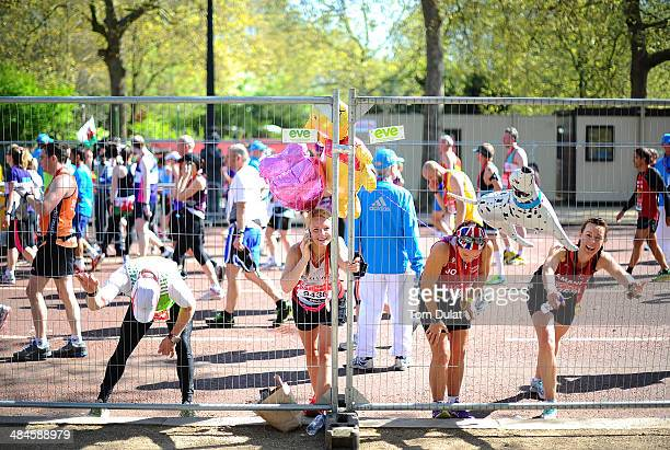Runners stretch after the Virgin Money London Marathon on April 13 2014 in London England