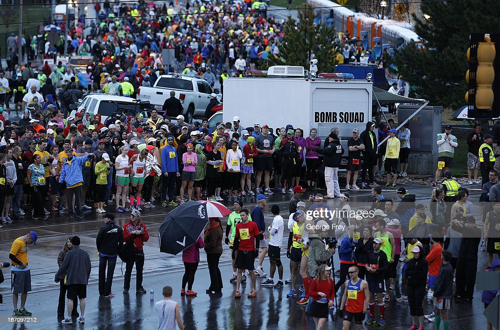Runners surround a bomb squad truck before the start of the Salt Lake City Marathon on April 20, 2013 in Salt Lake City, Utah. Due to the bombings at the Boston Marathon on April 15, security was dramatically increased by law enforcement and Utah National Guard at the Salt Lake City Marathon. Organizers are asking spectators to leave backpacks at home.