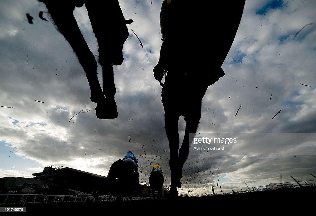 Runners take a fence in The Royal Artillery Gold Cup at Sandown racecourse on February 15, 2013 in Esher, England.