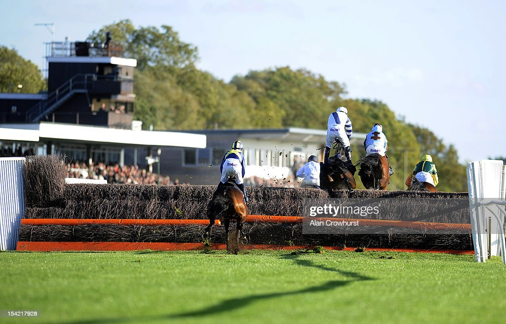 Runners take a fence in the straight at Huntingdon racecourse on October 16, 2012 in Huntingdon, England.