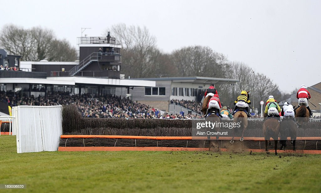 Runners take a fence infront of the grandstand at Huntingdon racecourse on March 03, 2013 in Huntingdon, England.