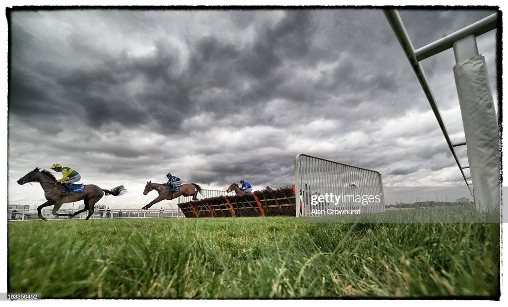 Runners take a flight of hurdles at Ascot racecourse on February 16, 2013 in Ascot, England.