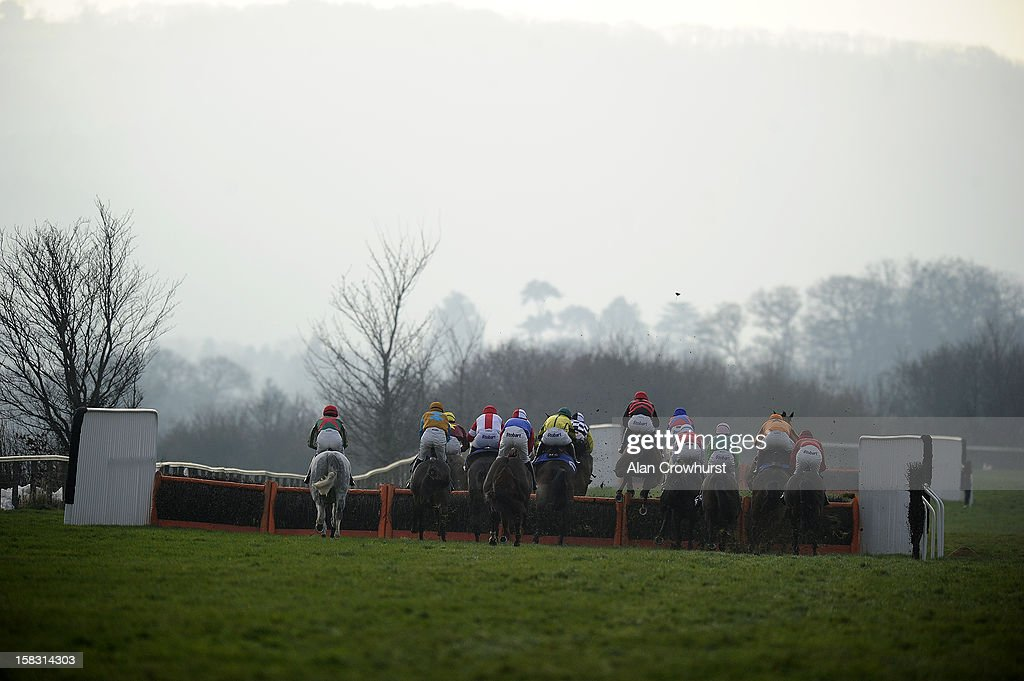 Runners take a flight of hurdles down the back straight in The Bathwick Tyres Taunton Handicap Hurdle Race at Taunton racecourse on December 13, 2012 in Taunton, England.