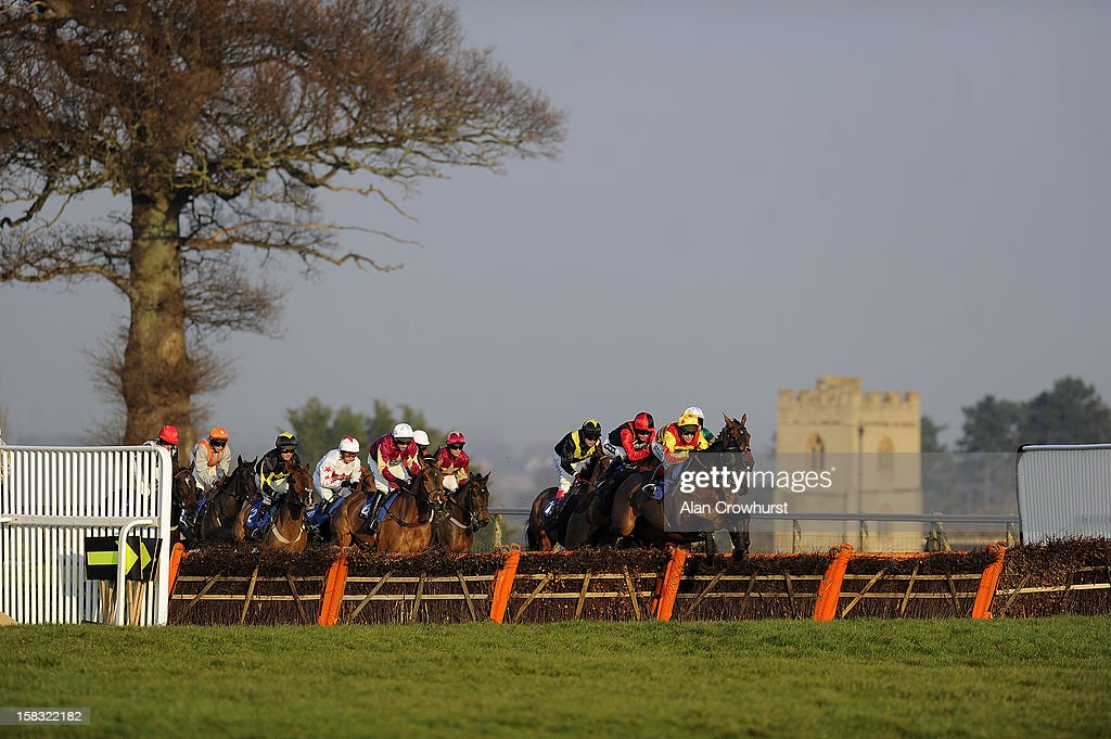 Runners take a flight og hurdles in The Setsquare Recruitment Novices' Hurdle Race at Taunton racecourse on December 13, 2012 in Taunton, England.