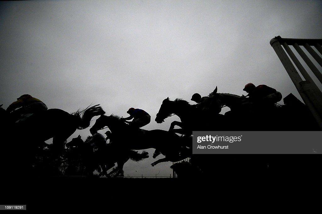 Runners take a hurdle down the back straight at Chepstow racecourse on January 08, 2013 in Chepstow, Wales.