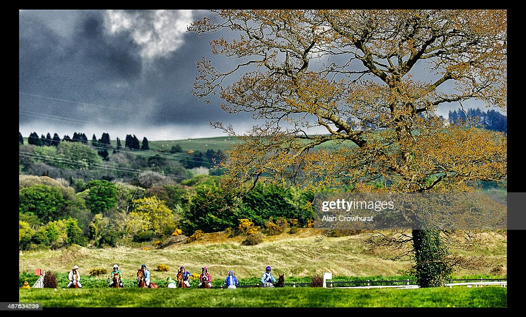 Runners take a look at the first fence in The Avon Ri Corporate & Leisure Resort Chase For The La Touche Cup at Punchestown racecourse on May 01, 2014 in Naas, Ireland.