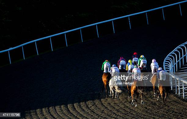 Runners take an early bend during The 32Redcom Handicap Stakes Race run at Kempton Racecourse on May 20 2015 in Sunbury England