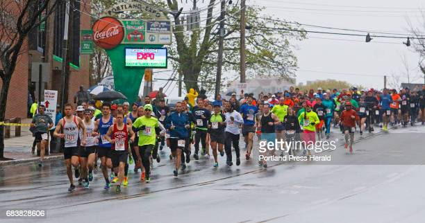 Runners take off at the start of the Portland Sea Dogs Mother's Day 5K road race