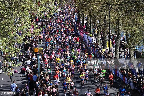 Runners take part in the 2014 London Marathon in central London on April 13 2014 World recordholder Wilson Kipsang won the men's London Marathon in a...