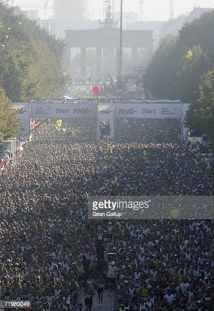 Runners take part in the Berlin Marathon near the start line September 24 2006 in Berlin Germany Haile Gebrselassie of Ethiopia won with an offical...