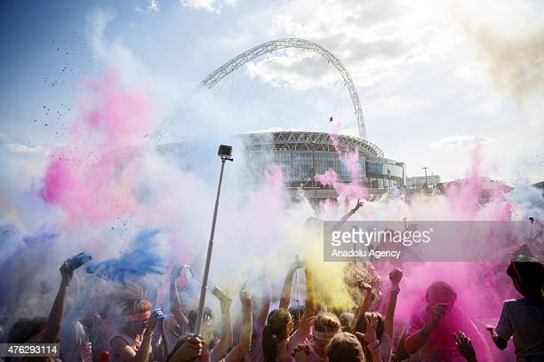 Runners take part in the Color Run around Wembley Stadium in London England on June 7 2015