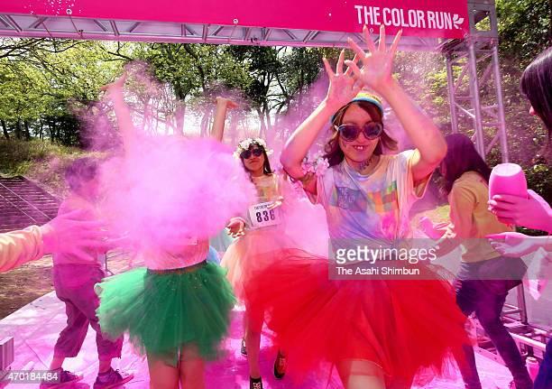 Runners take part in the Color Run at Hibikinada Ryokuchi Park on April 18 2015 in Kitakyushu Fukuoka Japan