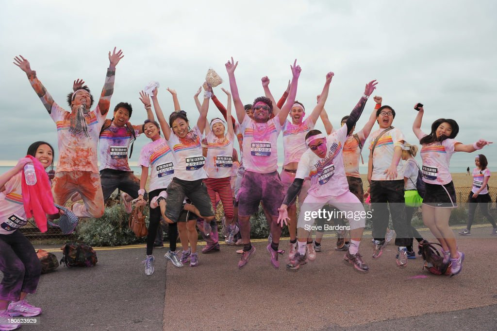 Runners take part in The Color Run presented by Dulux, known as the happiest 5km on the planet on September 14, 2013 in Brighton, England. Runners of all shapes, sizes and speeds start wearing white clothing that is a blank canvas for the kaleidoscope of colours they encounter around The Color Run course. At each kilometre a different colour of powder is thrown in the air with the runners becoming a constantly evolving artwork. At the end of the course runners are greeted by the Colour Festival where the air is filled with music and stunning coloured powder bursts creating a vibrant party atmosphere.