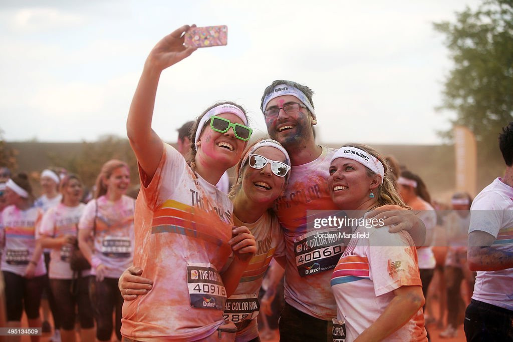 Runners take part in The Color Run presented by Dulux, known as the happiest 5km on the planet on June 1, 2014 in London, England. Runners of all shapes, sizes and speeds start wearing white clothing that is a blank canvas for the kaleidoscope of colours they encounter around The Color Run course. At each kilometre a different colour of powder is thrown in the air with the runners becoming a constantly evolving artwork. At the end of the course runners are greeted by the Colour Festival where the air is filled with music and stunning coloured powder bursts creating a vibrant party atmosphere.