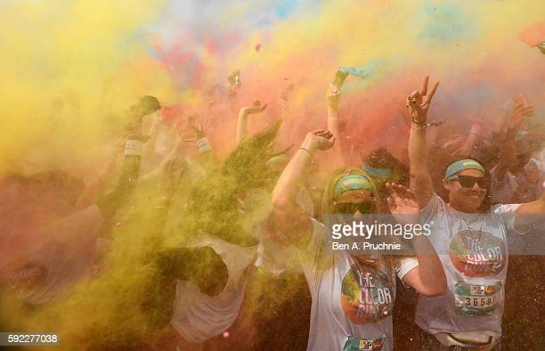 Runners take part in The Color Run presented by Skittles known as the happiest 5k on the planet on August 20 2016 in Birmingham England