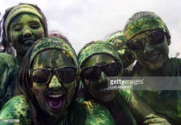 Runners take part in the Color Run race on November 3 2013 in Cali department of Valle del Cauca Colombia The Color Run is a 5 km race in which...