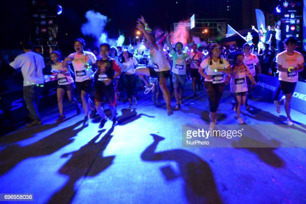 Runners take part in the Skechers Blacklight Run Thailand at Makkasan Airport Rail Link Station in Bangkok Thailand on 17 June 2017 Blacklight Run...