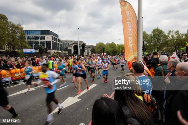 Runners take part in the Virgin Money London Marathon along Tower Hill on April 23 2017 in London England Around 40000 runners take part in the 37th...
