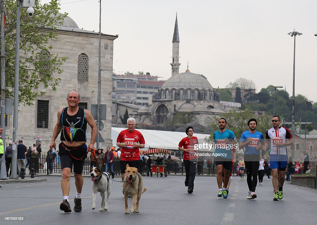 Runners take part in the Vodafone Istanbul Half Marathon on April 27, 2014 in Istanbul, Turkey. The 21.1-kilometer race organized by Istanbul Metropolitan Municipality, begins at the Old Galata Bridge in Balat, make a turn at Eyüp Hospital toward Kumkapi Fish Market and end in Balat at the same place it started.