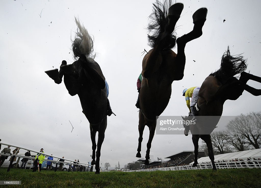 Runners take the fence in front of the grandstands at Plumpton racecourse on January 06, 2013 in Plumpton, England.