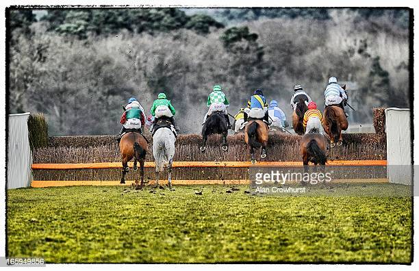 Runners take the first fence in The AP Security Veterens' Handicap Steeple Chase at Ascot racecourse on April 07 2013 in Ascot England