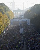 Runners take the start of the 41th edition of the Berlin Marathon near the Brandenburg Gate in Berlin Germany on September 28 2014 AFP PHOTO / TOBIAS...