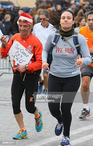 Runners take the streets for the 'We Run Rome 2013' race on the last day of the year on December 31 2013 in Rome Italy Thousands of people celebrated...