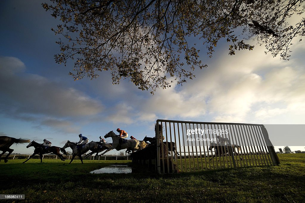 Runners take the water jump in The Bet With The Racing UK App Handicap Steeple Chase at Exeter racecourse on November 14, 2012 in Exeter, England.
