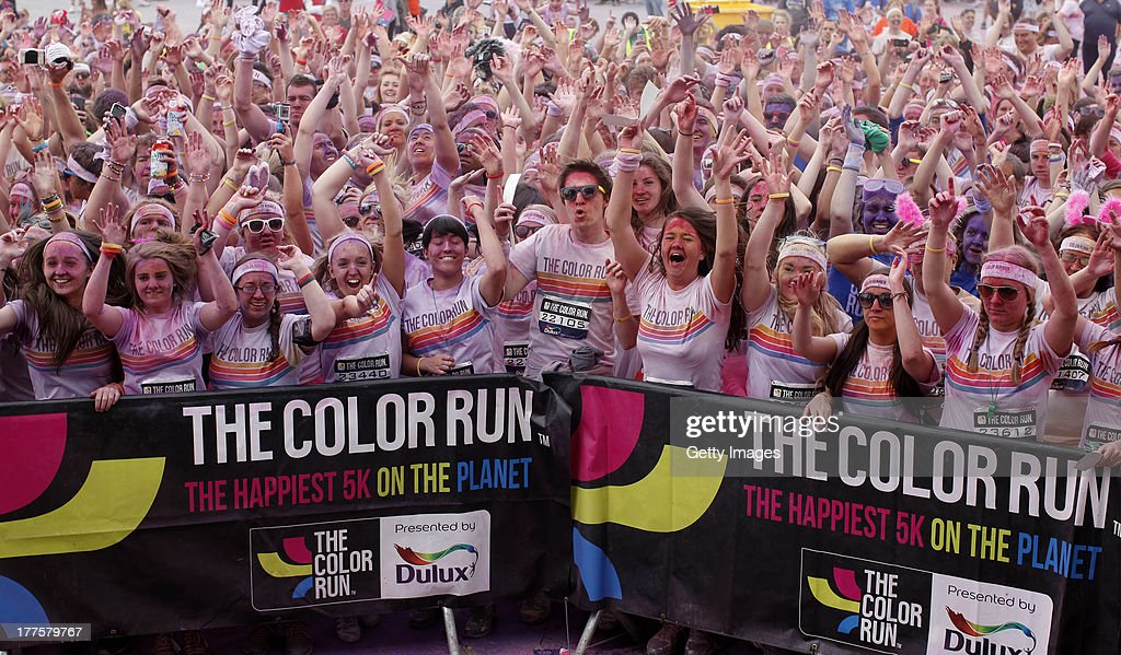 Runners takes part during the Color Run on August 24, 2013 in Belfast. Known as the happiest 5km on the planet, runners of all shapes, sizes and speeds wearing white clothing that is a blank canvas for the kaleidoscope of colours they encounter around The Colour Run course. At each kilometer a different colour of powder is thrown in the air with the runners becoming a constantly evolving artwork. At the end of the course runners are greeted by the Colour Festival where the air is filled with music and stunning colour powder bursts creating a vibrant party atmosphere.
