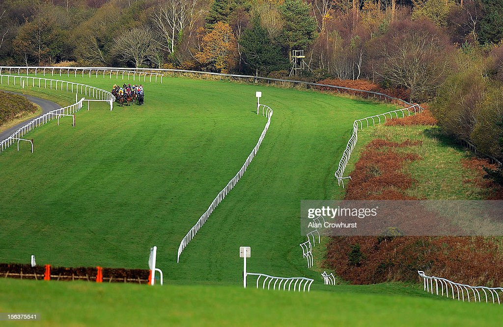 Runners turn into the back straight in The Aggregate Industries Stoneycombe Novices' Hurdle Race at Exeter racecourse on November 14, 2012 in Exeter, England.