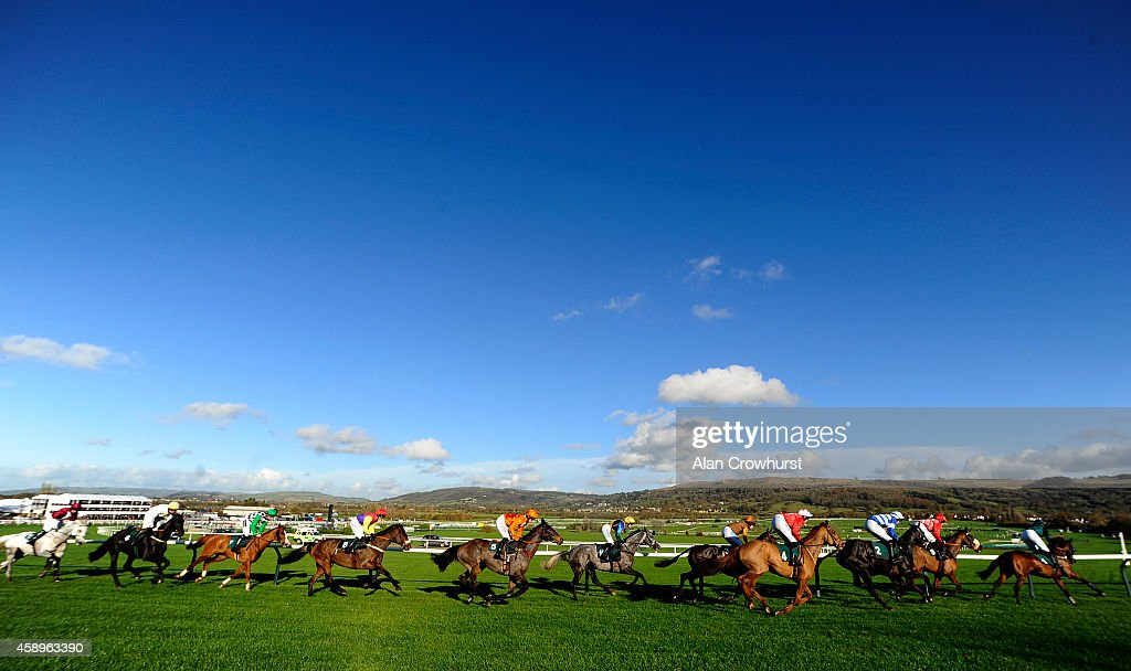 Runners turn into the back straight in The Opus Energy Amateur Riders' Handicap Steeple Chase at Cheltenham racecourse on November 14 2014 in...