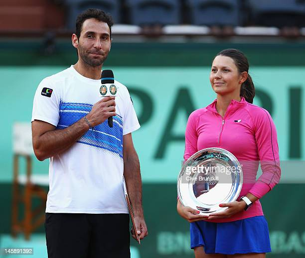 Runners up Santiago Gonzalez of Mexico and Klaudia JansIgnacik of Poland pose with their trophies after being defeated by Sania Mirza and Mahesh...