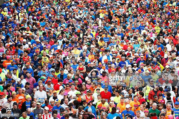 Runners wait at the starting line prior to crossing the VerrazanoNarrows Bridge at the start of the TCS New York City Marathon on November 1 2015 in...