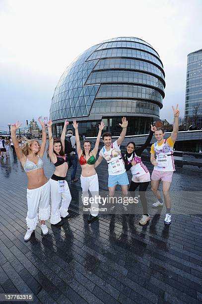 Runners warm up during the Team Pants And Bra photcall at City Hall on January 26 2012 in London England Team Pants and Bra sprinted through central...